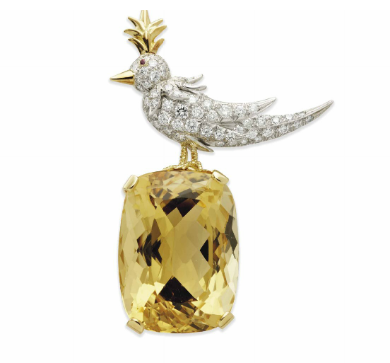 """""""Bird on a Rock"""" brooch of citrine of pavé diamonds with ruby eye mounted in gold, c. 1995, signed Tiffany & Co. Schlumberger, sold for $75,397 on estimate of $21,000-27,000 at Christie's Paris, December 2013."""