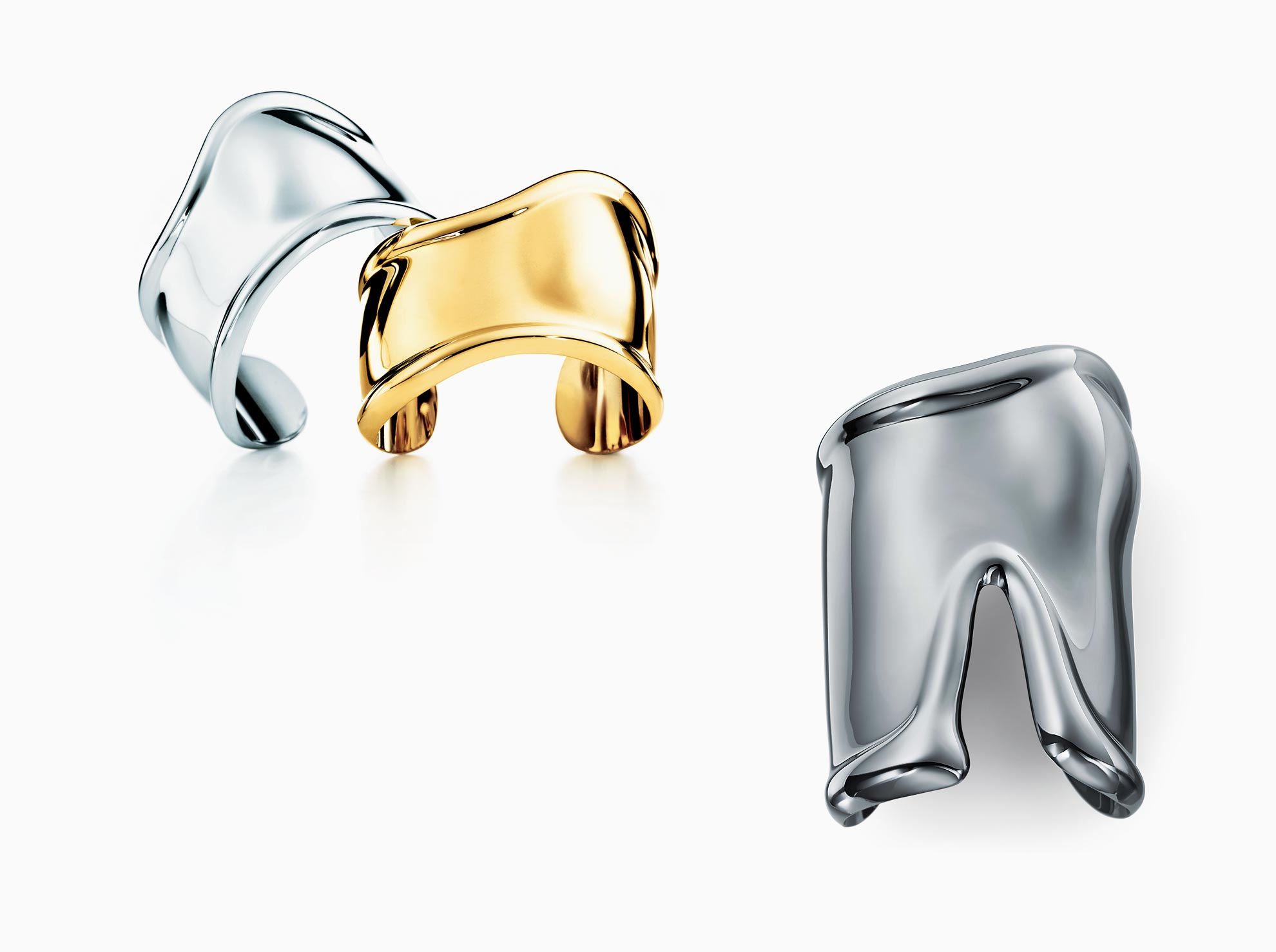 Designed in the 1970s, Elsa Peretti's Bone cuffs are still sold through Tiffany in a variety of metals, ranging from $495 for a small one in black-carbon over copper to $23,000 for a large 18k gold cuff. The British Museum added the Bone cuff to its permanent 20th century collection in 2009.
