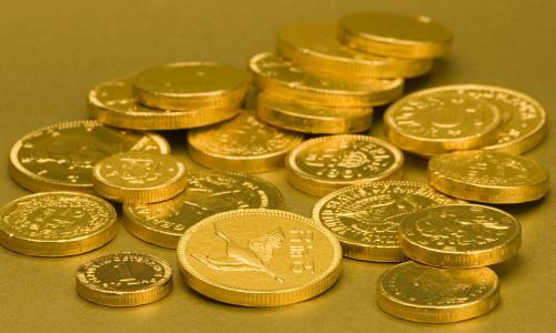 gold coins layed out (compressed)