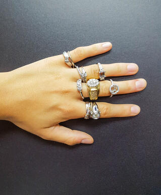 Diamonds rings on her NYC fingers